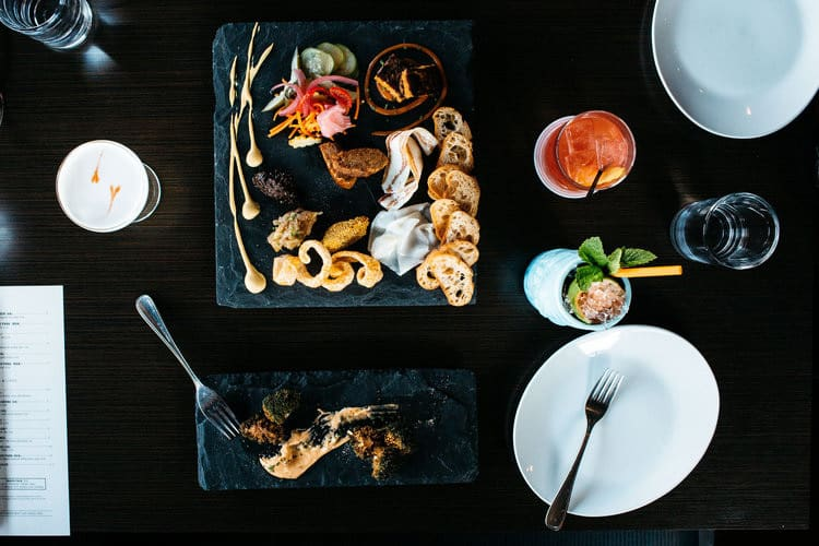 Heritage plate of appetizers and drinks